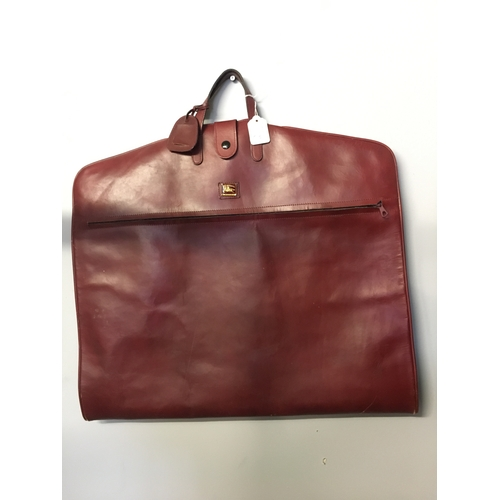 68 - A 1960's Burberry's leather suit bag....
