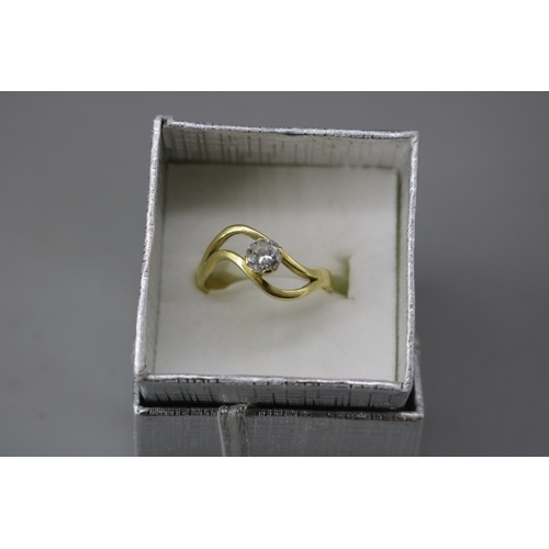 39 - An unmarked 18ct gold ring set with 0.25ct diamond approx size M...