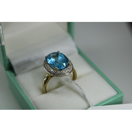 38 - 9ct gold QVC large blue stone and diamond chip surround approx size O/P...