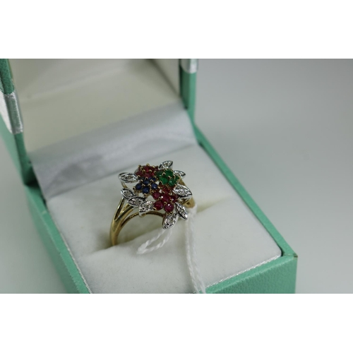 50 - QVC 9ct gold dress ring set with blue green and red stones surrounded by diamonds approx size O...