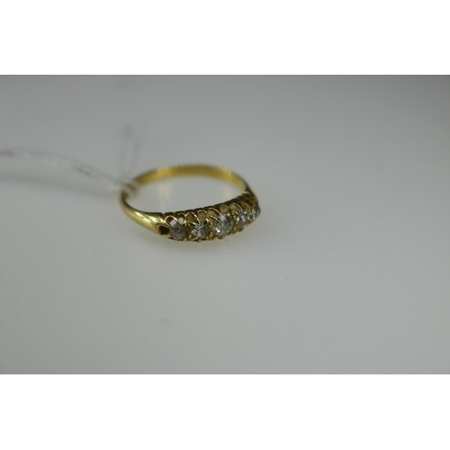 59 - An 18ct gold ring set with 5 illusion set small diamonds (approx weight 1.8g, approx size L/M)...