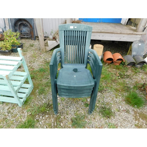 6 - Four high back plastic garden chairs...