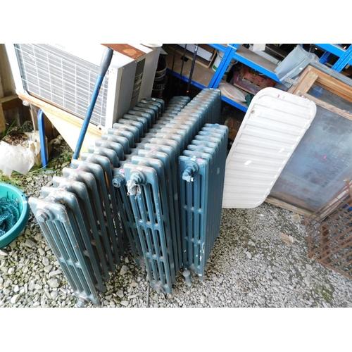 25 - Four cast iron radiators of various sizes...