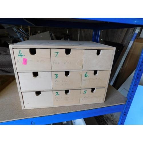 24 - Miniature work top nine drawer storage...