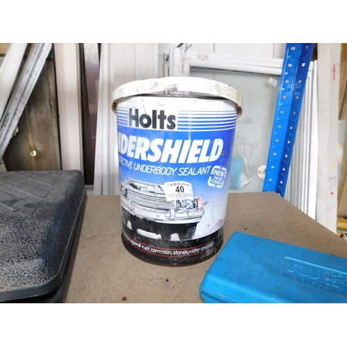 40 - Tin of unused vehicle underseal liquid...