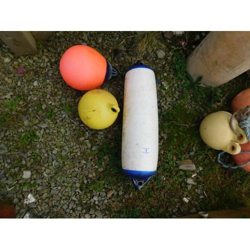9 - Three marine buoys...