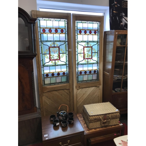 670 - Pair of stained glass pine doors...