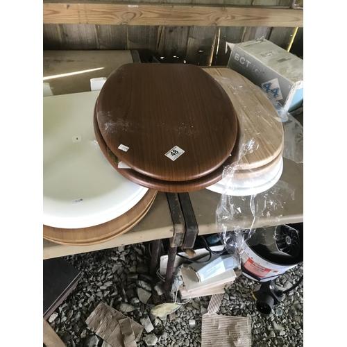 48 - 5 toilet seats (new)...