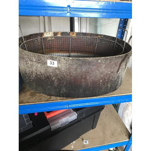 33 - Large cast iron handled bowl...