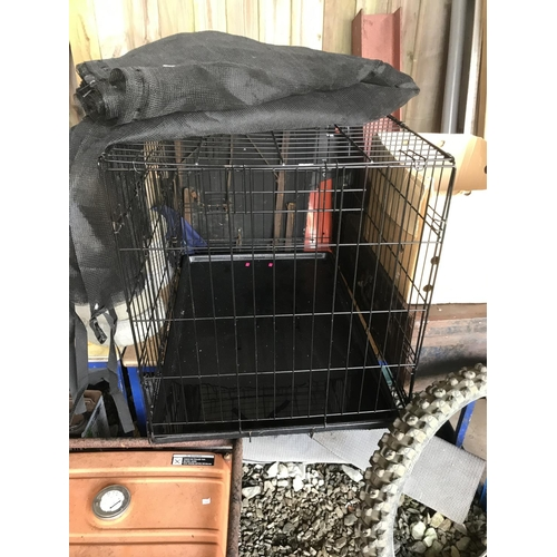 23 - A large dog crate...