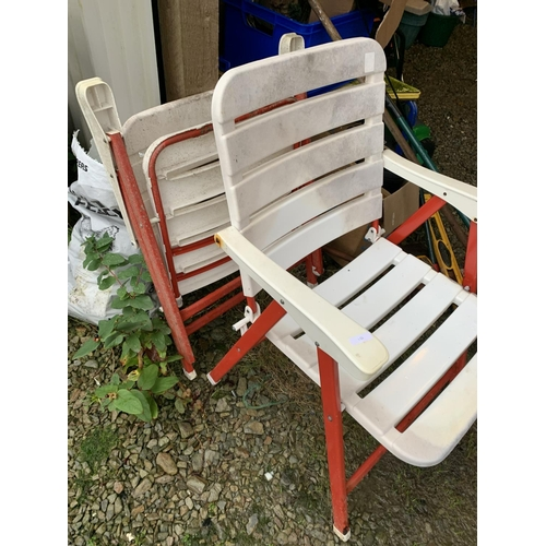 10 - Two plastic folding chairs...