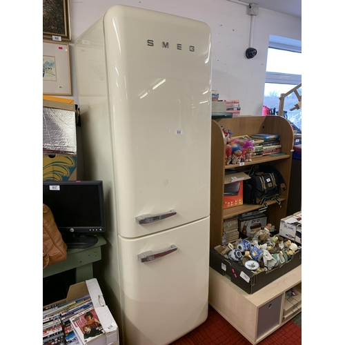 814 - Smeg fridge / freezer (2 years old GWO)...