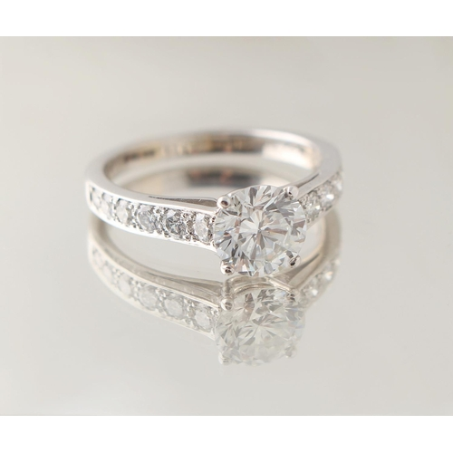 25 - A good certificated diamond solitaire ring, the round brilliant cut diamond weighing 1.26 carats, co...