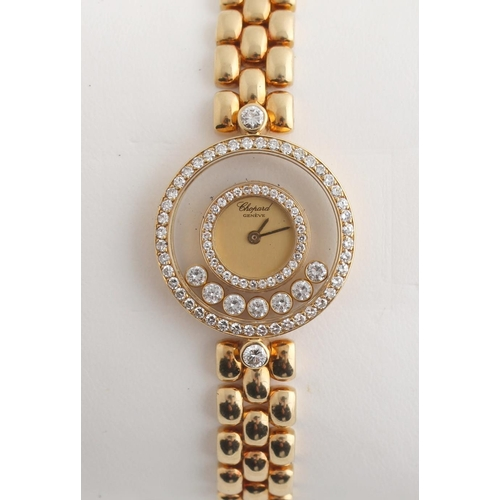 2B - Property of a lady - a lady's Chopard 18ct yellow gold cased 'Happy Diamonds' wristwatch, in excelle...