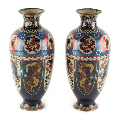 10 - A pair of Japanese cloisonne vases, circa 1900, decorated with phoenixes & dragons in panels, each 9...