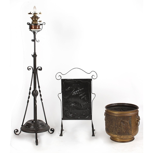 100 - Property of a deceased estate - an early 20th century black painted wrought iron adjustable lamp sta...