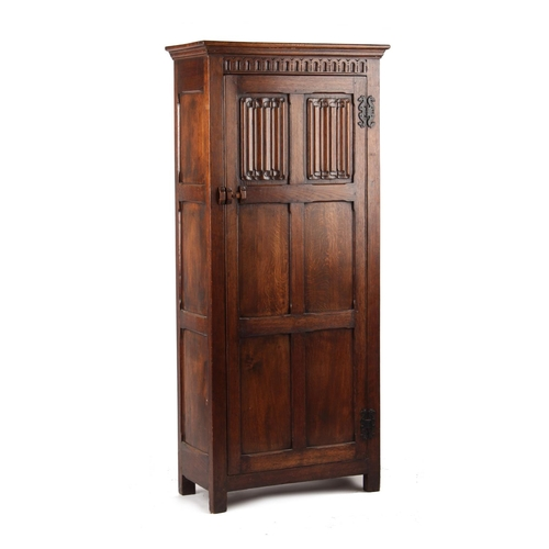 105 - A reproduction carved oak hall cupboard, with linenfold panels, 32.5ins. (82.5cms.) wide (overall) (...