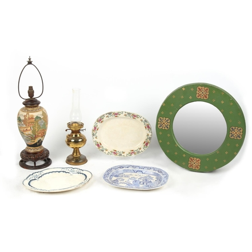 111 - A green painted circular framed wall mirror; together with two table lamps; and three meat-plates (6...