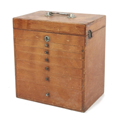 114 - Property of a gentleman - an early 20th century dentist's table top cabinet of drawers, with content...