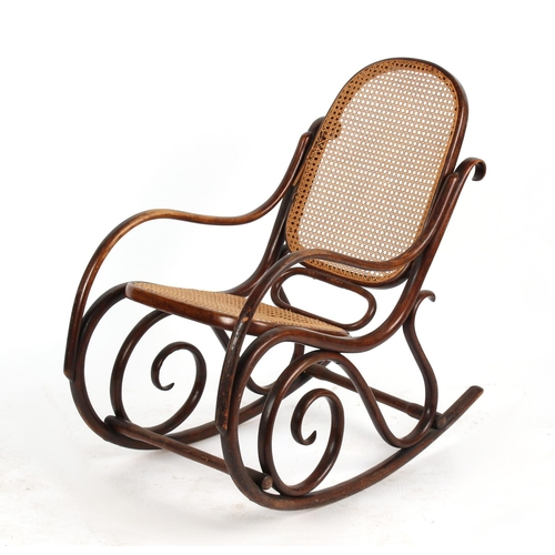 126 - Property of a gentleman - a late 19th / early 20th century bentwood & cane panelled rocking chair (s...