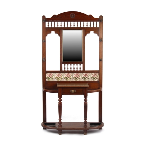 140 - A late Victorian walnut hallstand, inset with six floral decorated ceramic tiles, the drawer stamped...