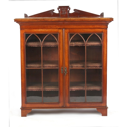 143 - Property of a deceased estate - an oak glazed two-door bookcase, the adjustable shelves with leather...