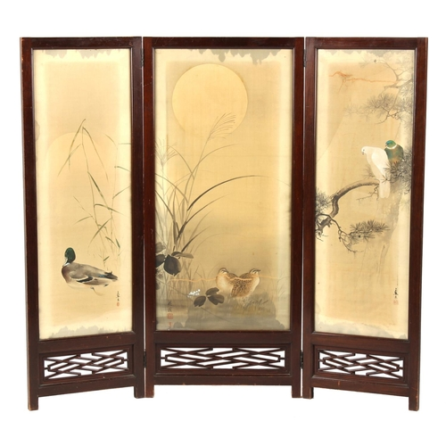 15 - Property of a lady - an early 20th century Japanese hardwood three panel screen with painted silk pa...