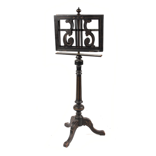 151 - Property of a deceased estate - a Victorian ebonised duet music stand, with tripod base, losses (see...