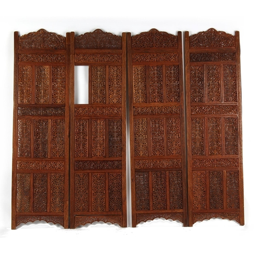 155 - An Indian carved teak four panel screen (F/R) (see illustration)....