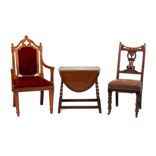 156 - A Victorian Gothic carved oak elbow chair; together with an oak barleytwist drop-leaf table; and an ...