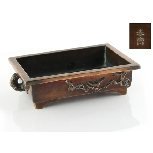 16 - Property of a gentleman - a Japanese bronze rectangular planter, decorated in relief with a bird in ...