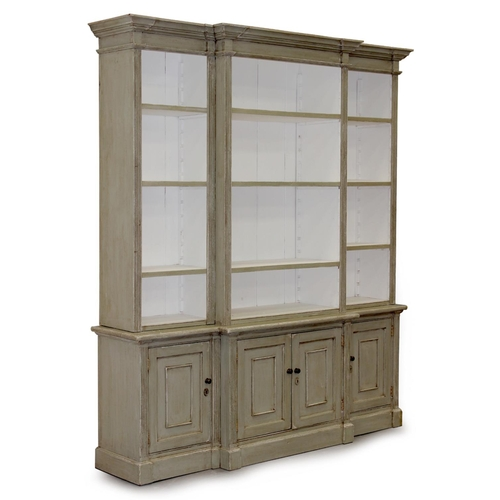 162 - Property of a gentleman - a pale green painted breakfront two-part bookcase, 78ins. (198cms.) wide (...