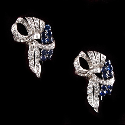 166 - A good pair of unmarked white gold sapphire & diamond tied ribbon clips, each set with nine round cu...