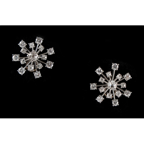 167 - A pair of Cartier 18ct white gold diamond earrings, with screw fastenings, the estimated total diamo...