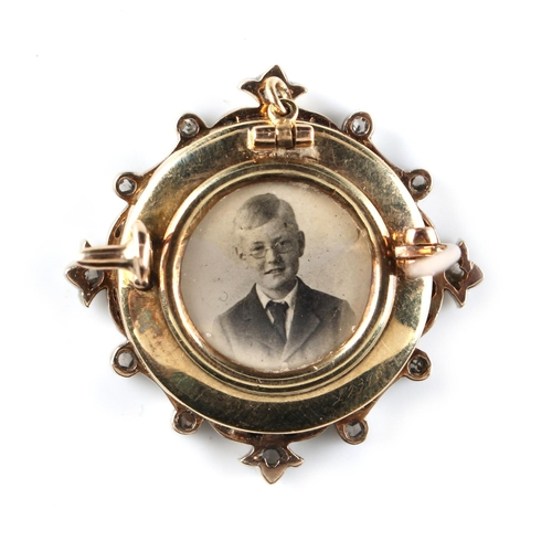 169 - A diamond & pale blue guilloche enamel pendant brooch, with portrait photograph to reverse, 1.1ins. ...