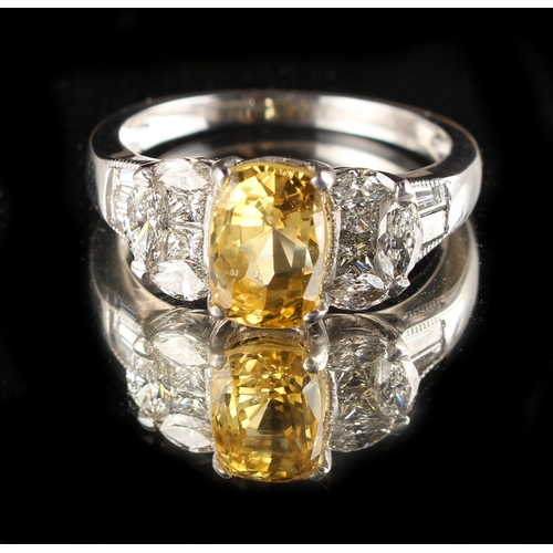 172 - A yellow sapphire & diamond ring, the central cushion cut yellow sapphire of clear vibrant colour & ...