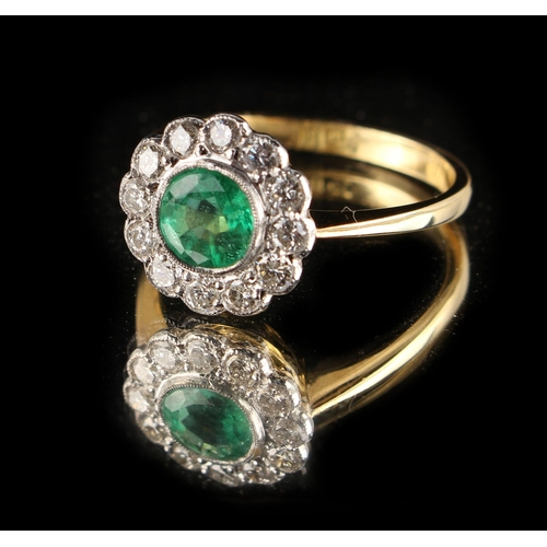174 - An 18ct yellow gold emerald & diamond cluster ring, the round cut emerald weighing approximately 1.0...