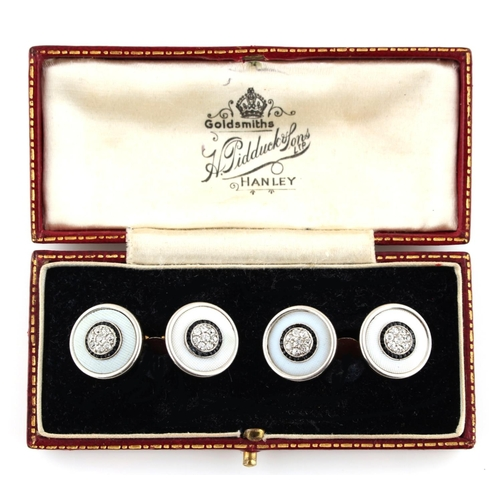 180 - A pair of yellow gold black onyx & diamond circular panelled cufflinks, approximately 11.8 grams tog...