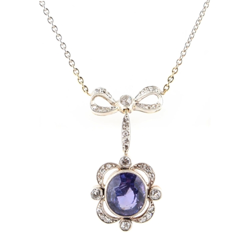 184 - A Belle Epoque style amethyst & diamond pendant necklace, the oval cut amethyst weighing approximate...