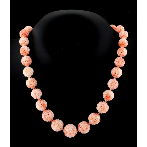 190 - A Chinese carved coral graduated bead necklace, the largest bead approximately 18.5mm diameter, indi...