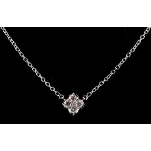 191 - A Cartier 18ct white gold & diamond stylised flowerhead pendant on chain necklace, set with five rou...