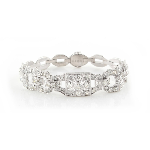 193 - A Swedish 18ct white gold diamond link bracelet, the estimated total diamond weight 5.11 carats, 6.5...