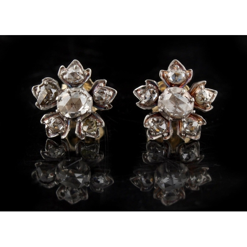 194 - A pair of diamond flowerhead cluster earrings, with post & butterfly fastenings, each set with six r...
