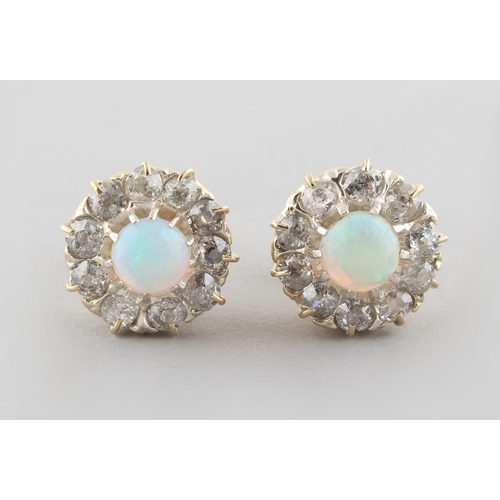 199 - A pair of opal & diamond cluster earrings, with post & butterfly fastenings, each with an opal set w...