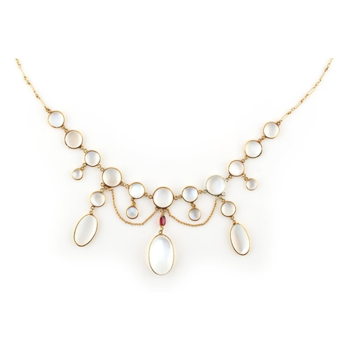 208 - An unmarked yellow gold moonstone & ruby festoon necklace, 16ins. (40.5cms.) long (see illustration)...