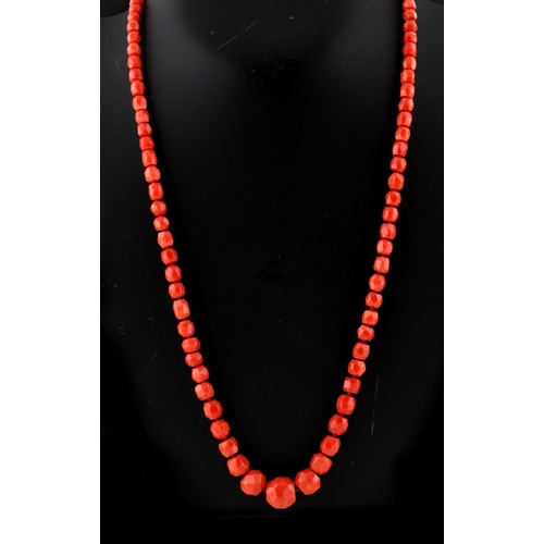 209 - A Victorian faceted coral bead necklace, with eighty-seven individually strung graduated beads, the ...