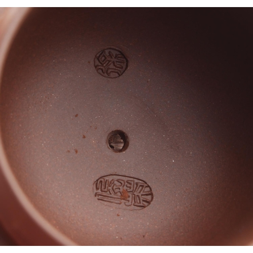 215 - Property of a lady - two Chinese Yixing teapots, both with impressed seal marks to undersides & to i...