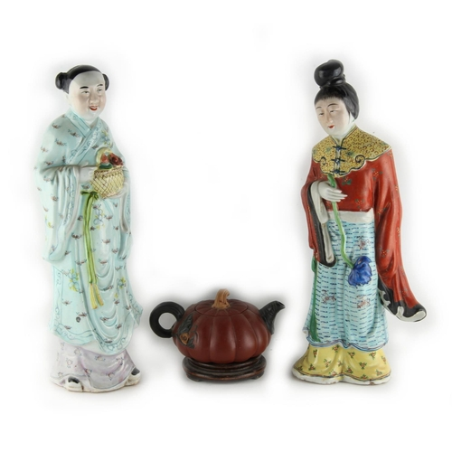 216 - Property of a lady - two Chinese polychrome glazed porcelain figures of ladies, 20th century, impres...