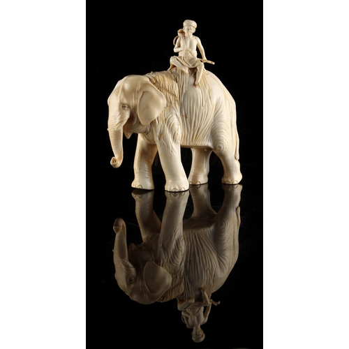 22 - Property of a gentleman - a Japanese carved ivory okimono modelled as a standing elephant with rider...