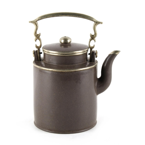 228 - An early 20th century Chinese Yixing teapot, with white metal mounts, impressed mark to base, 7.7ins...